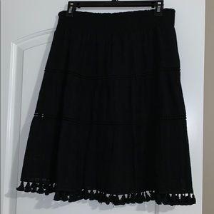 Knee length linen skirt with tassels.